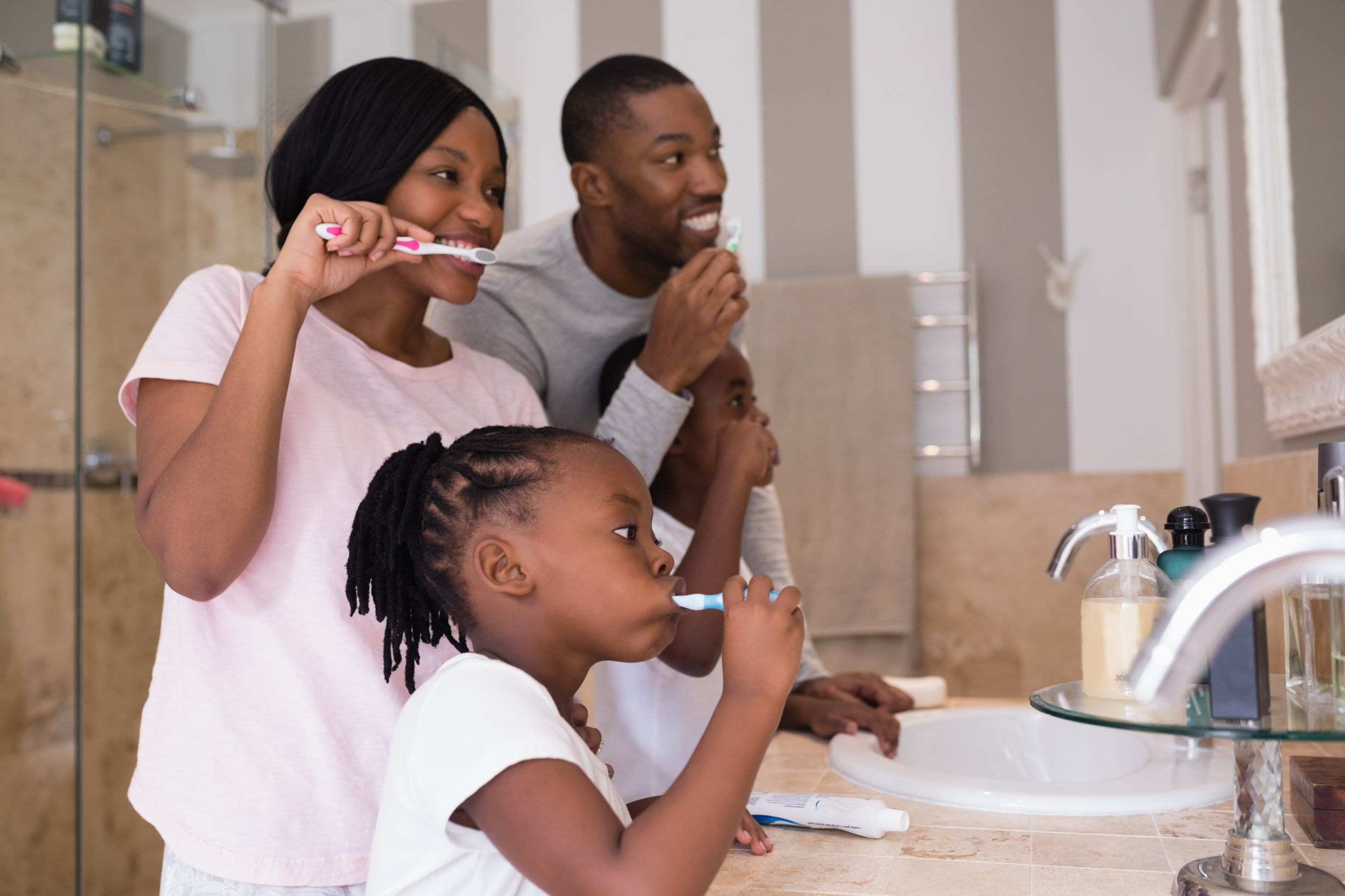 family brushing their teeth