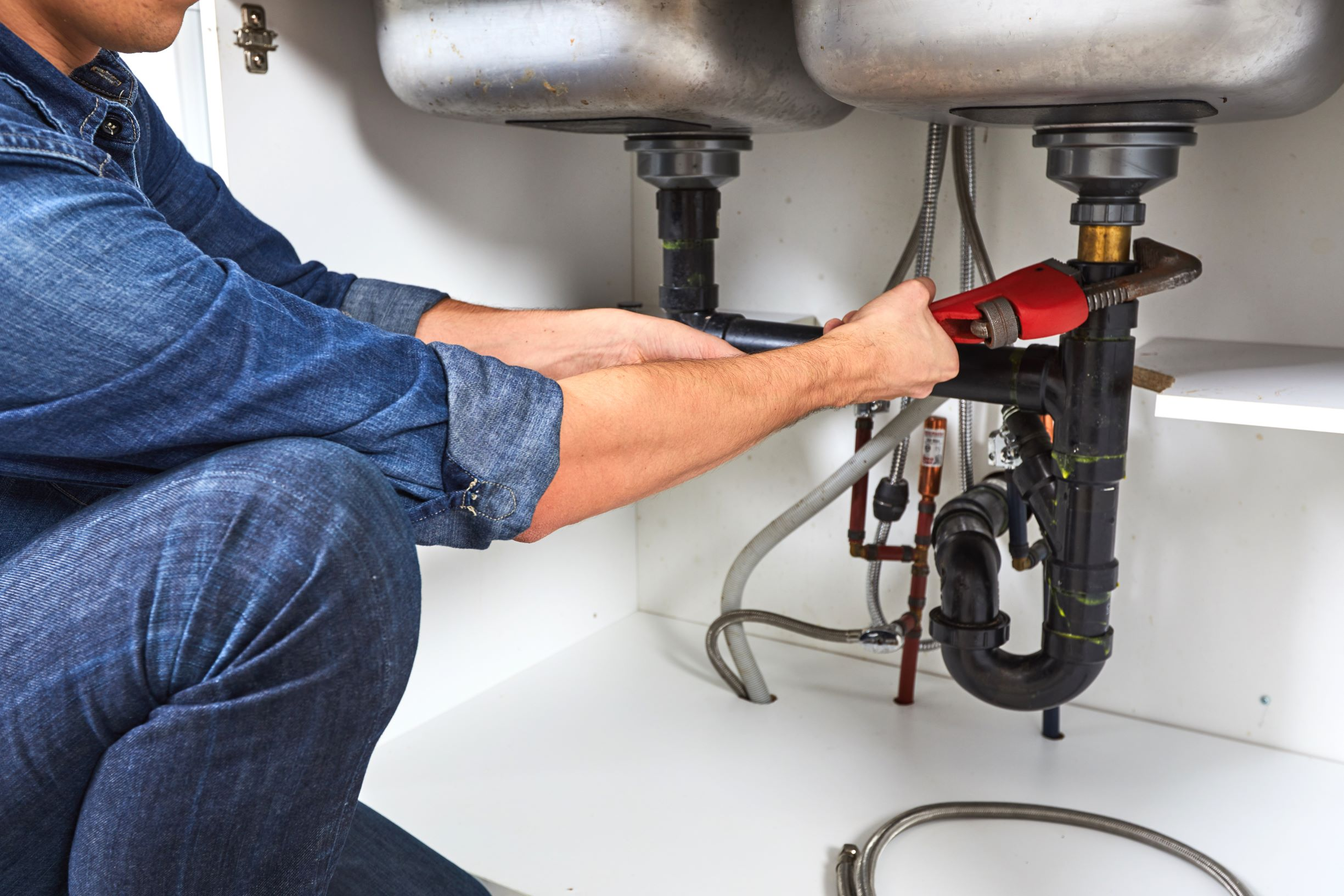 plumber fixing pipes